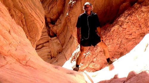 Rick straddling Anniversary Narrows, Lake Mead, Nevada