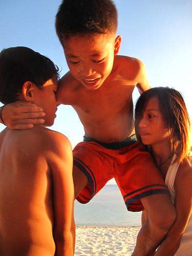 Acrobatic kids, Malapascua, Philippines