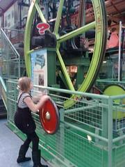 Skye turning a flywheel at Enginuity!