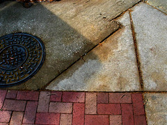 Manhole Cover Brick Sidewalk Lines Geometry