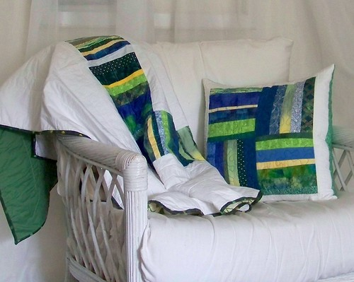 Blue-green quilted pillow and lapquilt