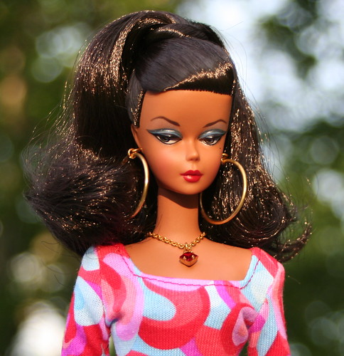 Ms. Klugh? Naomi? Rose? no, it's Barbie on the Island