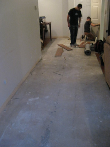 Workers ripping up old floor