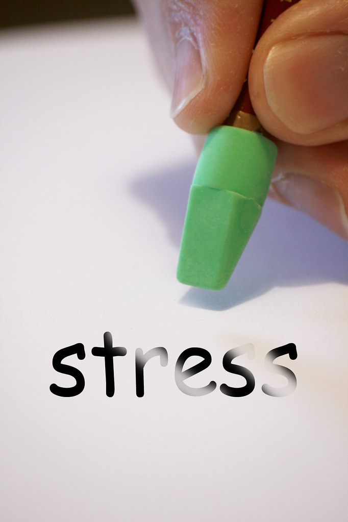 an eraser whiping out stress