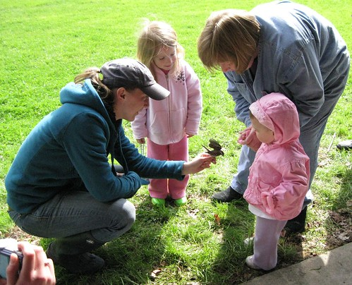 Emily shows bird to Grandma and Granddaughters
