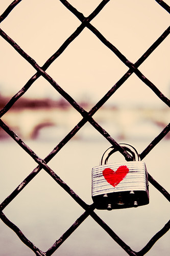 padlock on a gate with a red heart painted on it