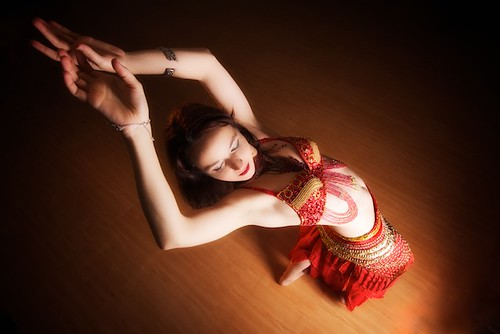 A belly dancer dances seductively.