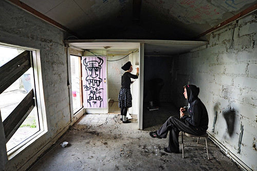 3 squatters painting