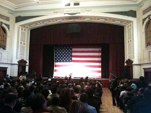 I am now inside an auditorium with hundreds (thousands?) of people waiting to be sworn in