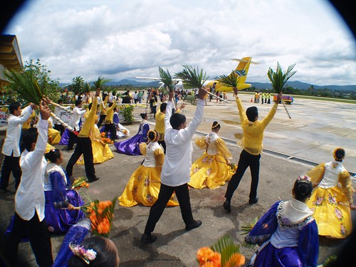 A local high school dance group greets the maiden Pagadian flight of Cebu Pacific as it touches the airport in Zamboanga Del Sur.