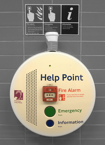 In the UK they like using 'point' to name things. This is a help point. They also have cash points instead of bank machines.