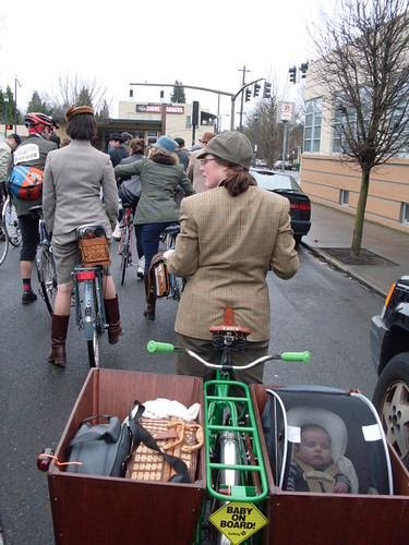 Wooden cargo boxes on a longtail can carry baby and groceries!