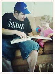 Flora and @seanm77 reading a book together