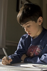 boy, with homework by woodleywonderworks, on Flickr