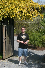 Sean near gate with flowering vines overhead
