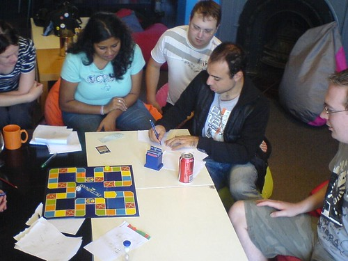 Playing Pictionary boardgame at Cafe Games