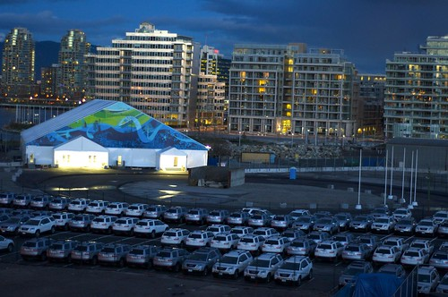 Fleet of official vehicles outside Olympic Village tent