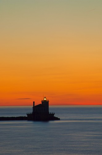 Oswego Harbor West Pierhead Lighthouse after sunset from Fort Ontario in Oswego, New York