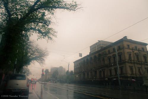 Spring street in rain