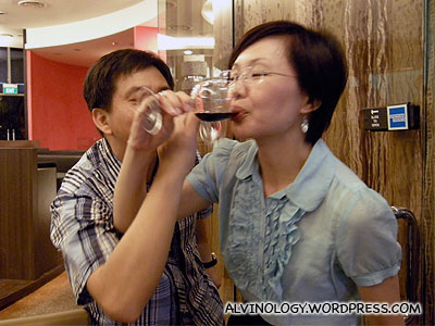 Boss Kuan Fung, forced to cross wine glasses with our funny Uncle Teik