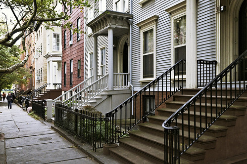 clapboarded frame row houses (c. 1828), 141 He...