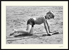 Scrawny kid on beach!