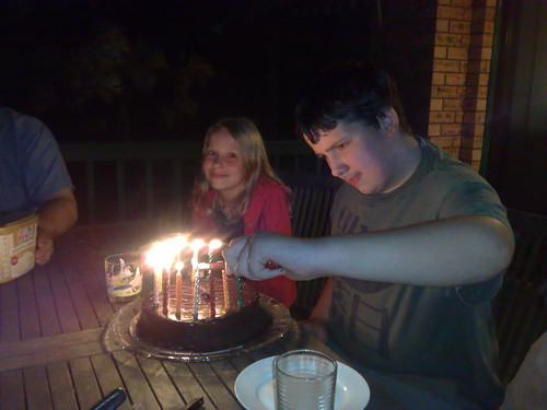 Lighting his own candles