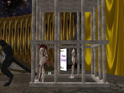 Zombies in Cage at Phantasmagoria Circus