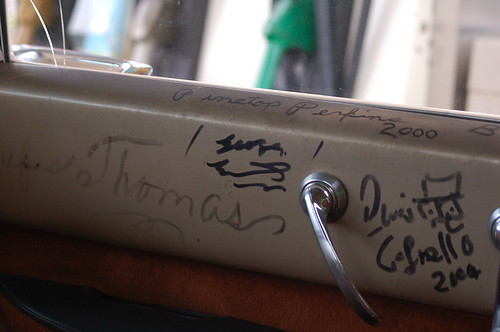 Autographs on the door of Tad Piersons Cadillac