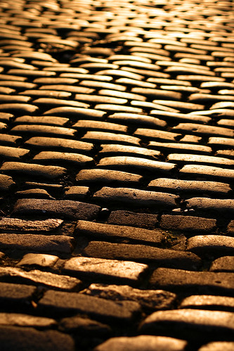Stone driveway in the warm sunset.