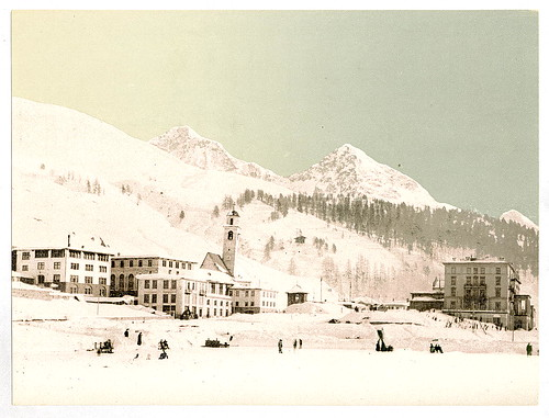 [Winter scene with buildings, snow covered peaks in the background, unidentified location] (LOC)