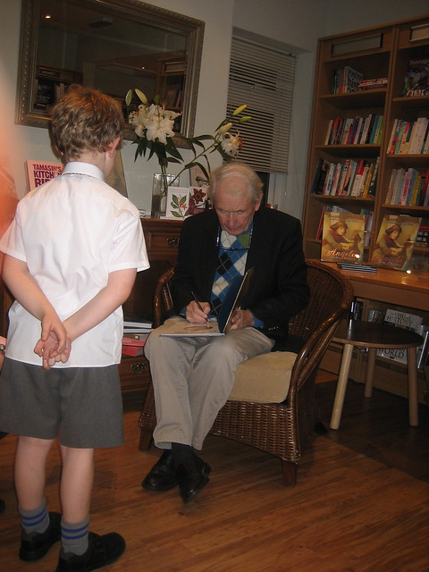 Frank McCourt and small boy in front of bookshelves