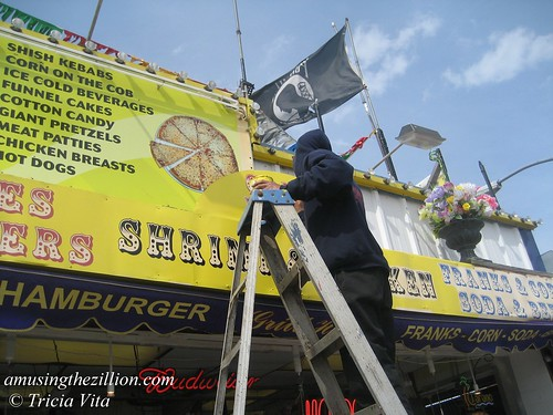 Touching Up the Sign at Steve's Grill House on the Boardwalk. Photo © Tricia Vita//me-myself-i via flickr