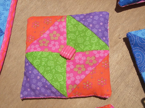 Embellished sachet in pink, orange, green and purple