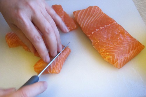 Adeptly slicing the salmon