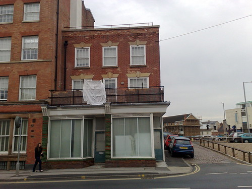 Wow. Zoom in to read banner. They're facing a house with Tory posters.