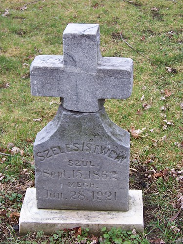 Tombstone for Szeles Istwein with a squarish base that curves up into an equal-armed, unadorned cross