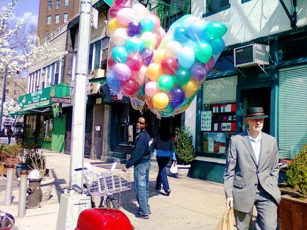 man with dapper hat trumps balloons
