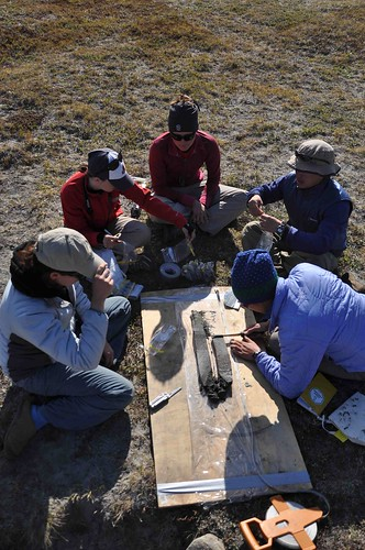 Team IGERT examines a sediment core. Photo by Chris Polashenski