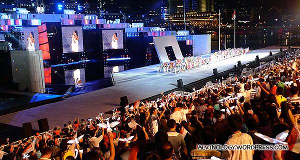 "Singapore's Tabitha Nauser, leading the YOG theme song, ""Everyone"""