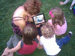 Gathering around the iPad to watch Thoma by metaviews, on Flickr