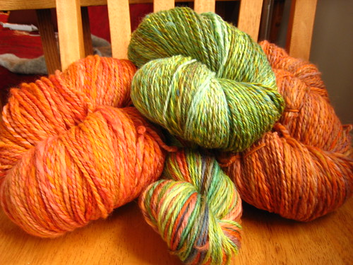 green and orange yarns