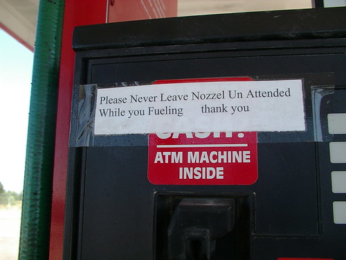 funny sign on gas pump