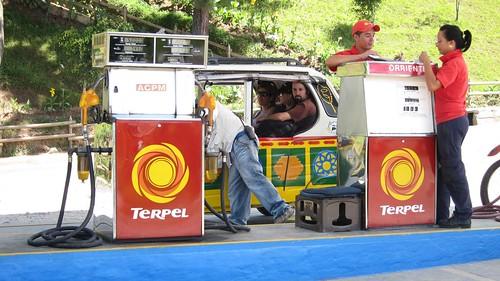 Pitstop to refuel the tuk-tuk we took from Guatape to El Penol.