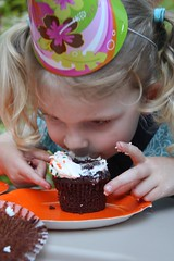 Claire enjoying her birthday cupcake