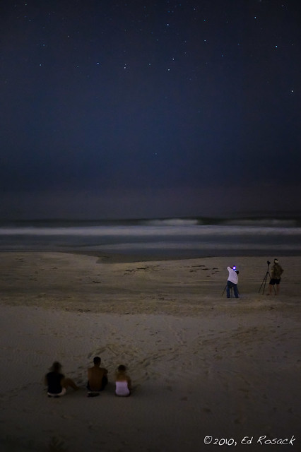 Grasshopper and Donuts perform photo-magic on the beach under the stars for an audience of three.