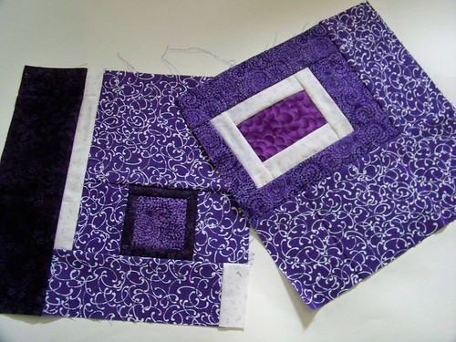 Purple improvisational quilt blocks for rainbow around the block