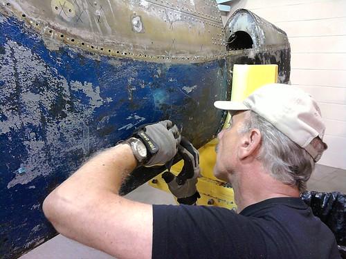 Bob Bracci slowly removing paint