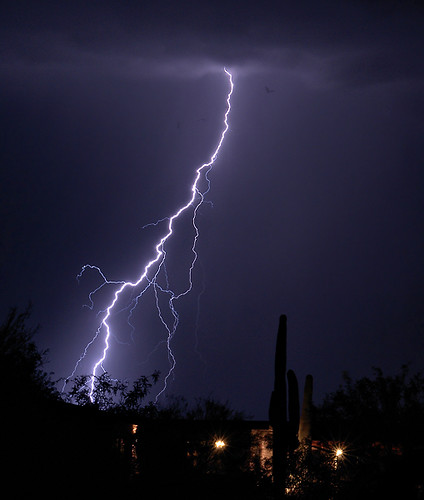 Monsoon lightning - see the birds flying around? by SearchNetMedia