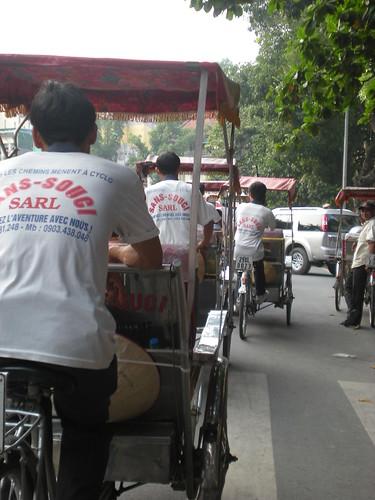 Hanoi - Trishaws on the road